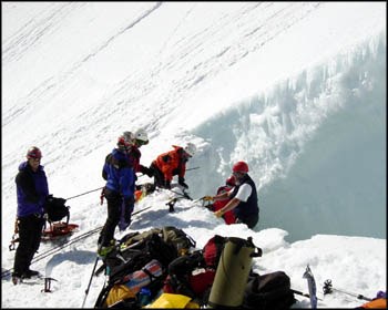 PMR rescuers prepare to recover the bodies of three deceased mountaineers at 10,700 feet in Mount Hood's Bergschrund crevasse.